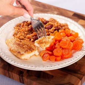 Country Catfish Filets with Candied Carrots, and Cajun-Style Red Beans and Rice